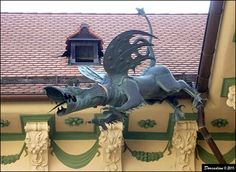 This unusual huge copper gargoyle, in the shape of legendary Brno Dragon, you can find in the first courtyard of the Baroque complex of the New Town Hall (Nová radnice) in Brno...