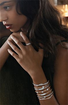 Love the whole thing!  Bony Levy stackable wavy rings and Charriol bangles.