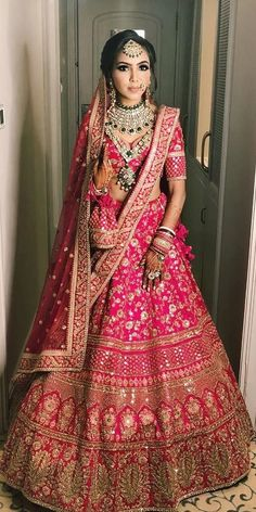 30 Exciting Indian Wedding Dresses That You'll Love is part of Pink bridal lehenga - Indian wedding dresses are very beautiful Usual indian bridal dresses made of chiffon or silk and adorned with elaborate embroidery, red or gold color Pink Bridal Lehenga, Indian Wedding Lehenga, Designer Bridal Lehenga, Indian Lehenga, Sabyasachi Lehengas, Pink Lehenga, Bridal Sarees, Indian Bridal Outfits, Indian Bridal Wear