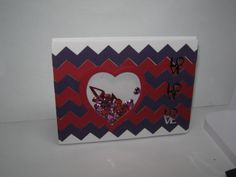 Valentine Shaker card made by Sharon Frees.  I used a zig-zag die & heart is from Tattered Lace. Down the right side are the work LOVE in confetti.