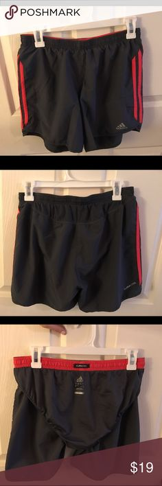 Adidas medium running shorts Adidas medium dark grey and coral pink running shorts. They have the panty on the inside of the shorts shown in the photo above. I rarely used these. I don't generally like to wear shorts when I work out. But they are super comfy & are pretty close to new looking. Please feel free to ask any questions or make an offer (: Adidas Shorts
