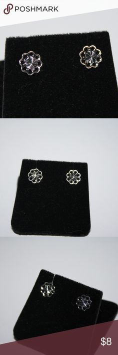 .925 sterling flower earrings .925 stamped. beautiful little flower earrings with diamond cut center that just sparkles in the light.  Buy from me with confidence! I have sold over 400 items with a 5 star rating! If you have any questions, do not hesitate to ask.  Looking at a few things in my shop? Put a bundle together, and save! Jewelry Earrings