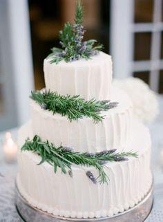 white wedding cake with pine tree decors