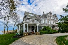 Nestled on the mouth of Little Harbor, this classic Cape Cod-style home offers seaside views at every turn.