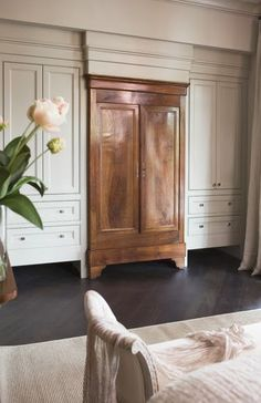 Good way to break up the wall of built-in cabinets. COTTAGE AND VINE: Antiques Repurposed