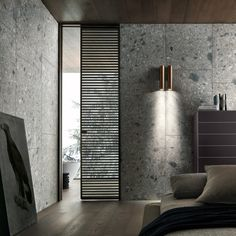porta Even nella versione scorrevole slim, caratterizzata dallo stipite di minimo spessore. Struttura alluminio brown e vetro trasparente grigio.
