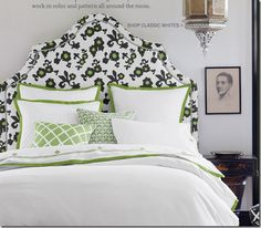 Love the shape of this upholstered headboard