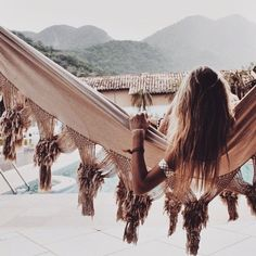 Wishing it was me lounging in this amazing macrame hammock by the pool!