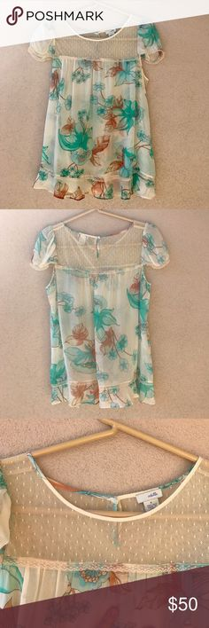 "Anthropologie Odille Sheer Floral Silk Blouse Beautiful, 100% silk blouse by Odille from Anthropologie.  This blouse has a delicate mesh neckline, a blueish green, turquoise floral pattern throughout, lace trim, and a ruffled bottom hem.  Excellent condition with no flaws except the tiniest, barely noticeable dot in the last photo.  - Size 4 - Approx. 19"" armpit to armpit - Approx. 25"" long - 100% silk  - Closet ID # 0032 Anthropologie Tops Blouses"
