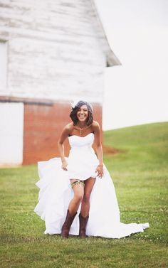 Bride with camouflage garter and cowboy boots. Yeehaw!