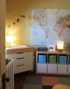 A Photographic Ode to IKEA's Expedit in Kids' Rooms Changing table in corner with mobile ...