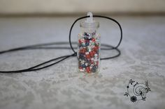 This is a unique pendant made of colourful beads in a small bottle. It's a lightweight pendant and it will not feel like a millstone around your neck. They say that a picture is worth a  thousand words and so there are 5000 words above to describe this unusual pendant.  The dimensions are approx. Height 4.5cm Dia. 1.3cm | Shop this product here: http://spreesy.com/delightgallerycrafts/17 | Shop all of our products at http://spreesy.com/delightgallerycrafts    | Pinterest selling powered by…