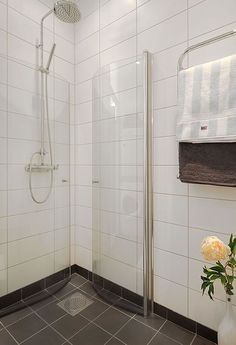Make the most of a small bathroom by using a shower stall that folds away when not in use. What a fab idea.