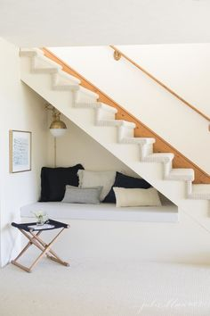 These under stair nooks are perfect for additional storage, furniture and cozy space. These ideas feature desks, shelves and plenty of cozy pillows. Under Stairs Nook, Stair Art, Escalier Design, House Stairs, Cottage Stairs, Bed Stairs, Entryway Stairs, Rustic Entryway, Home Decor Ideas