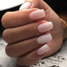 Pale pink ombre nails with accent glitter nail