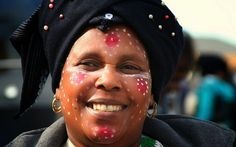 A Xhosa woman's social position is shown by what she wears and how she wears it. A man's style of traditional dress bears a similar message.