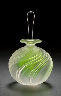"""Apple Green Swirl Perfume"" Art Glass Perfume Bottle created by Mary Angus - a bright green core glows within this elegant blown glass bottle, highlighting its carved spiral design. Love how the clear glass stopper contrasts beautifully with the bottle's frosted surface..."