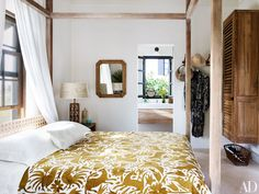 Tom Scheerer's Bahamas Vacation House | The pickled-white-acacia four-poster in one guest room was designed by Scheerer.