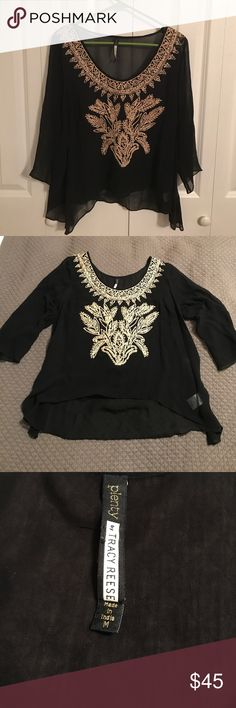 Plenty by Tracy Reese black and gold sheer top This beautiful Plenty by Tracy Reese sheer black top features a gold embroidery detail on the front and and a flowy detail on the bottom. It's in perfect condition and has only been worn once. Plenty by Tracy Reese Tops Blouses