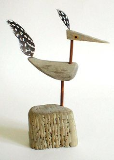 Driftwood bird with feathers by Robert Race.