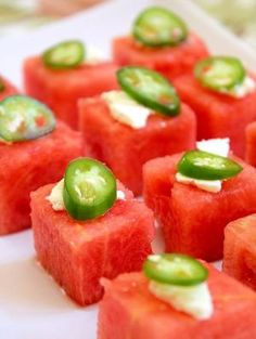 "Watermelon Salad Bites  ~ The combination of cool, sweet watermelon, acidic lime juice, spicy slices of serrano chile, and crumbled salty feta cheese don't immediately strike your guests as a ""salad,"" until they take a bite, and the flavors rearrange and combine into something all new. The combination is startling, cooling, and satisfying. They're inexpensive, perfect for a crowd, and easy to prepare (especially if you start with a seedless watermelon). by jaine.mylam"