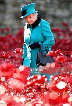 Queen Elizabeth II visits the Blood Swept Lands and Seas of Red evolving art installation at the Tower of London on October 16, 2014 in London, England. 888,246 poppies will be planted in the moat by volunteers with the last poppy being planted on the 11th November 2014. Each poppy represents a British or Colonial fatality in the First World War. The poppies are for sale with 10% plus all net proceeds going to six service charities.  (Photo by Chris Jackson - WPA Pool /Getty Images)