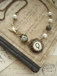 Typewriter Key Jewelry - Yellow Letter Q Vintage Typewriter Key Necklace in Antiqued Brass. Sparrow, Rose, Filigree, Pearls. Garden Jewelry.. 54.50, via Etsy.