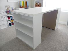 craft table - I made a table for my craft room using 2 small bookshelves from Wal-Mart and the Vika Amon desk top from IKEA. I added 6 canvas bins to each bookcase area for even more storage. The whole table only cost $55 and can be easily taken apart and moved if needed.