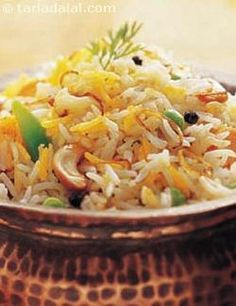 Vegetable biryani is the most popular and the most common rice dish that comes to one's mind when you think of indian cuisine. . . It is very tasty and definately worth a try !