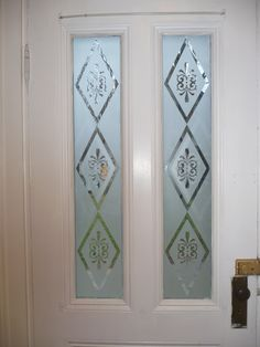 eching Replaced front door windows (original was frosted/etched & one was missing) made these myself in the bathtub, with etching creme. Glass Etching Designs, Glass Partition Designs, Frosted Glass Design, Replacing Front Door, Etched Glass Door, White Interior Doors, Pooja Room Door Design, Front Doors With Windows, Sandblasted Glass