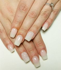A clean, classic and understated French manicure accented in Swarovski Crystal Pixie in Cute Mood