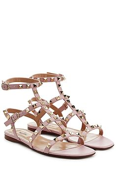 Informed+by+pretty+pink+leather,+Valentino's+signature+Rockstud+gets+a+pared-down+remix+with+these+easy+flat+sandals+#Stylebop