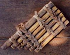 Weathered panpipes with leather strips