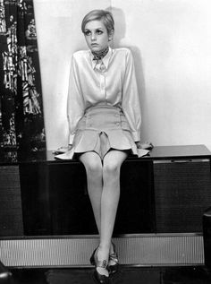 Twiggy sits on a console