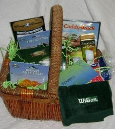 A great item for the silent auction at your favorite charity golf event!  Fathers and Bosses may enjoy this one, too.  This basket may include a golf towel, Caddyshack DVD, ball markers, golf balls, golf tool, tees and other golf novelty items.  GLAM UP YOUR BASKET with a PRO SHOP gift certificate or Greens fees.