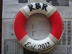 DIY Nautical Life Ring Preserver ~ Life Saver The tube/ring can be bought at your local crafts store. Then paint, add rope and decorate with stencils.