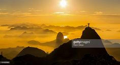 Panoramic view at sunrise in Rio de Janeiro with Christ the Redeemer, Sugar Loaf, Botafogo Bay and Guanabara Bay. City of Niterói in the background.