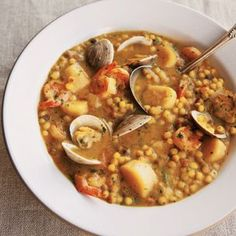 Saffron Fregola with Seafood. A hearty stew with pasta from the Italian island of Sardinia. The more common Israeli couscous may be substituted.