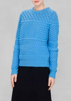 Cozy and eye-catching, this cotton-blend sweater is constructed from contrasting knitted techniques for a chic and playful twist.