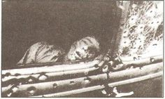 Photo of Clyde Barrow as he appeared in death slumped against the door of the bullet-riddled Ford Fordor Deluxe sedan.