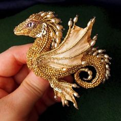 By now we've seen all kinds of dragons, from the ones made of felt to the wooden ones. Yet Russian master of embroidery, Alyona Lytvin, still managed to surprise us with her miniature dragons made out of beads. Beaded Brooch, Beaded Jewelry, Handmade Jewelry, Brooches Handmade, Jewellery, Beaded Bracelets, Handmade Beads, Bead Crafts, Jewelry Crafts