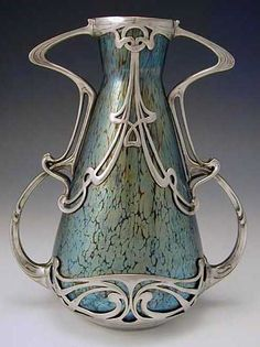Loetz irridescent glass vase with pewter Art Nouveau mount. 1905
