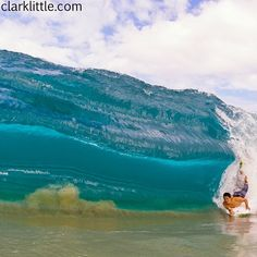 Photo by clarklittle.  Shorebreak and Jerret Lau getting some Hawaii perfection.