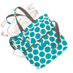 Retro Metro Fold-Over, It's the perfect everyday tote or school bag. It fits folders and notebooks in the main compartment and the interior zipper pocket is sized just right to store your tablet. Carry it by the two shoulder straps as a tote or fold the top over and use the long strap to wear as a crossbody.