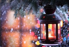 Christmas Lantern -- Why do people really put up Christmas lights? I think part of it is tradition, but for me it is much more. The lights are a symbol of Christ the light of the world. Plus, they look so pretty against the pure white snow. (via muddy rivers)