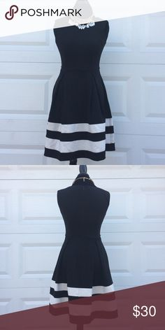 Calvin Klein Black and White Dress. Black and white dress from Calvin Klein. Fitted at the torso with white stripes on the bottom. Perfect for a semi formal event. Calvin Klein Dresses Midi