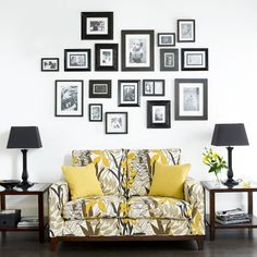Create a family photo wall that will grow over time as your family does. It will form a focal point above a sofa and add a personal touch. Emphasise the feature wall by framing the sofa with matching tables and lamps either side.