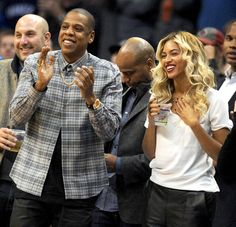 Jay Z and Beyonce take in the action at a basketball game between the Oklahoma City Thunder and the Los Angeles Clippers at Chesapeake Energy Arena.