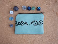 Blue dragon dice bag, small zippered pouch in hand-printed ultrasuede showing two black dragons on a light blue fabric by GreenMarthaBoutique on Etsy