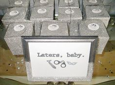 Send your guests off with a smile and some gray glittered takeout boxes. Laters, baby
